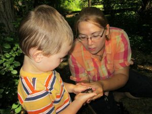 Exploring the wildlife at summer camp.